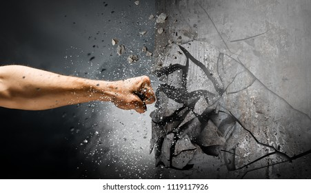 Hand breaking through the wall. Mixed media
