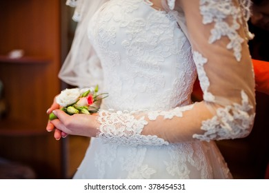 Hand of bride with boutonniere