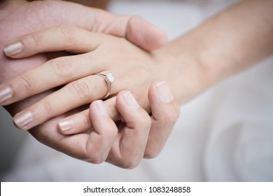 Hand of bride and groom