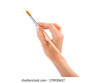 Hand with a brush isolated