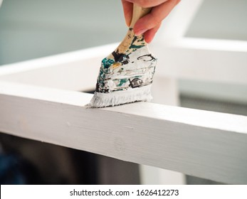hand with brush painted wood