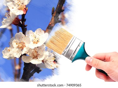 Hand with brush painting natural image. Spring concept.