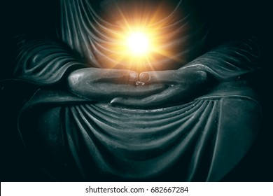 hand of buddha with light of wisdom and power of breath in religion of asian concept.