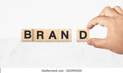 hand building brand on white background