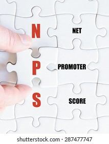 Hand of a business man completing the puzzle with the last missing piece.Concept image of Business Acronym NPS as Net Promoter Score