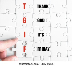 Hand of a business man completing the puzzle with the last missing piece.Concept image of Business Acronym TGIF as Thank God It's Friday