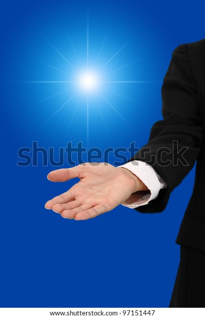 Hand of business man give light of chance.