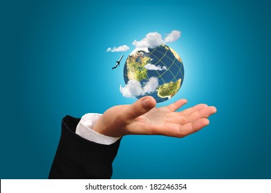 Hand of Business Man hold earth globe with airplane and cloud