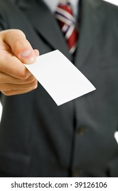 Hand of business man offering business card