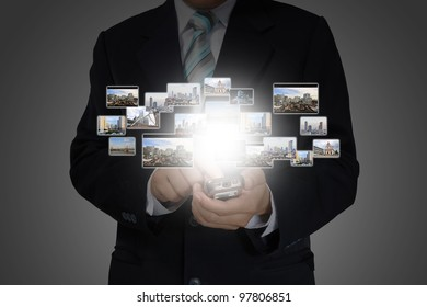 Hand of Business Man Pressing or Pushing touch screen of Mobile Smartphone on Photo sreaming