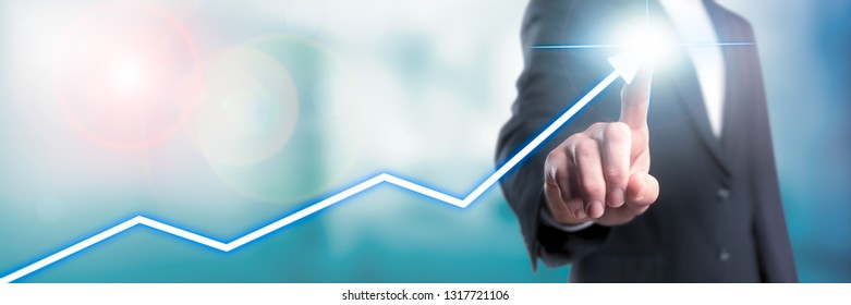 Hand Of Business Man Touching Top Of Modern Growth Chart - Business / Financial Success Concept