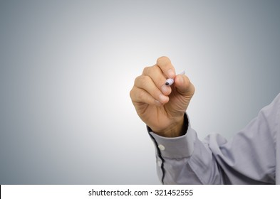 Hand of business man writing on tablet pc touch screen with gradient gray background.