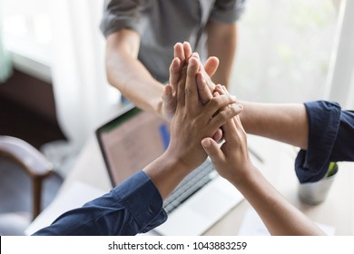 hand of business man,business matching , connecting puzzle elements , team work