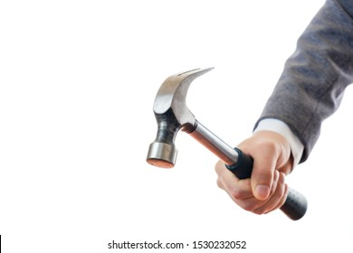 Hand in a business suit holds a hammer on a white background, isolate.