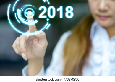 Hand business woman pressing a 2018 year start button. New year a future part