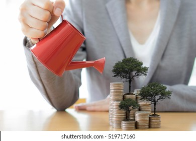 hand business woman and red watering can with money