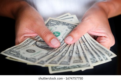 Hand of business woman  she holds the dollar usa economic and financial concepts.