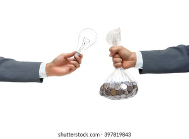 hand of a businessman buying a light bulb - Investment on new idea and innovation concept