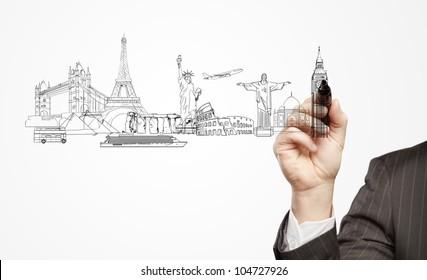 hand businessman draws a architectural buildings