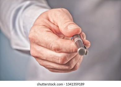 Hand of the businessman giving you a pen to sign contract