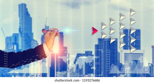 Hand of a businessman holding dart on city background.Targeting the business concept.