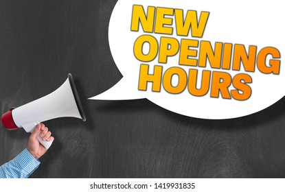hand of businessman holding megaphone or bullhorn against blackboard with text NEW OPENING HOURS in speech bubble