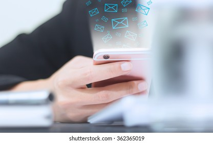 Hand of businessman holding phone icon appears on screen the phone.