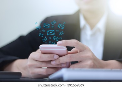 Hand of businessman holding phone icon appears on the screen