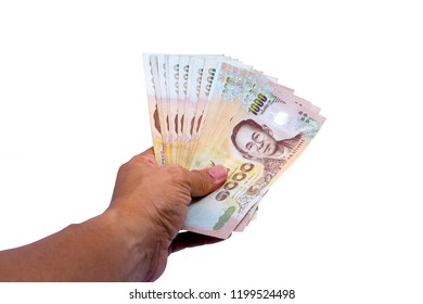 Hand of a businessman holding a thailand currency, Hand holding 1000 bath Thai money isolated on white background with clipping paths.