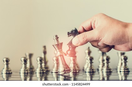 hand of businessman moving chess figure in competition success play. strategy, management or leadership