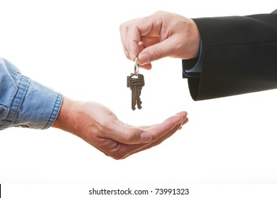 Hand of businessman passing a set of keys to another hand. Clipping path isolated on white.