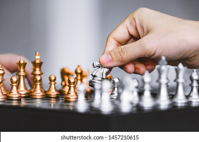 Hand of businessman play chess figure on chessboard game, business strategy game concept