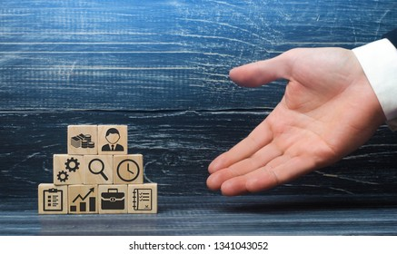 The hand of a businessman presents a recipe from business elements and attributes for a successful business. The correct construction and structure of the business, good leadership and innovation