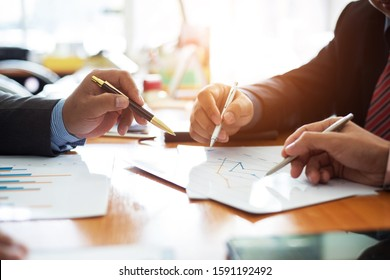 Hand businessman team is analyzing the cost of housing projects to live with lifestyle.business concept, soft focus, vintage tone