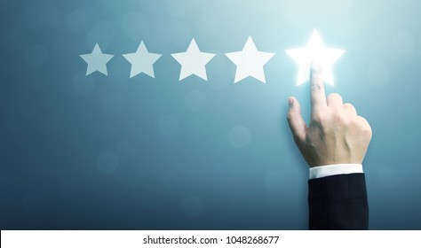 Hand of businessman touching five star symbol to increase rating of company concept, Copy space background for your title