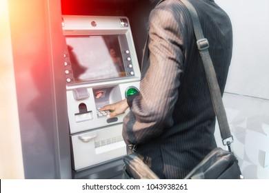 Hand businessman typing on ATM, bank machine