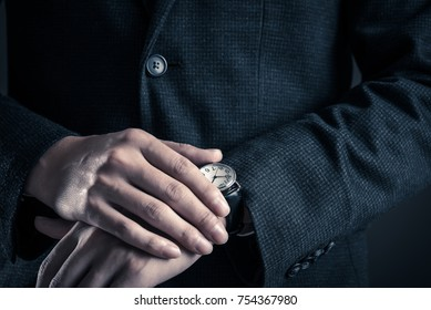 Hand of a businessman wearing a suit