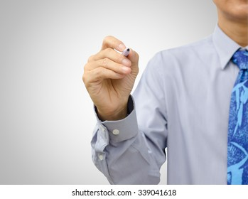 Hand of businessman writing on tablet pc touch screen with gradient gray background.