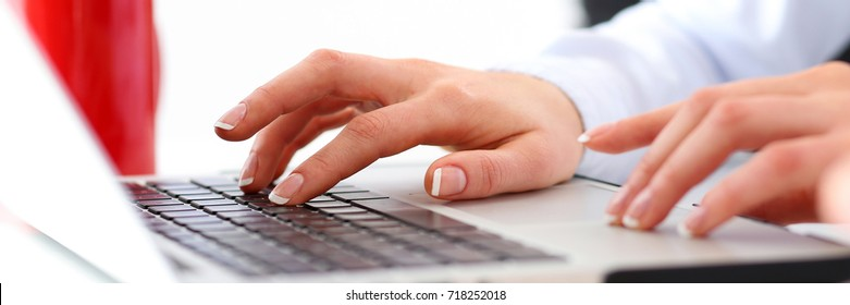 Hand of businesswoman press button at laptop computer while presentation or seminar. Fresh look, review situation, new angle view, professional training, white collar, investment and finance concept