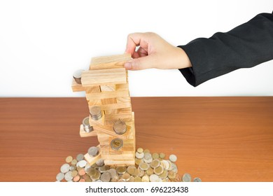 hand of businesswoman pulling out or placing wood block isolated on white background,Planning, risk and strategy in business, investment, finance