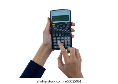 Hand of businesswoman using calculator against white background