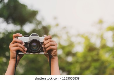 Hand and camera and travel.Photography or traveler Concept.