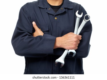 Hand of car mechanic with a wrench. Isolated over white background.