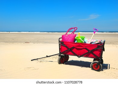 Hand cart with vacation luggage at the beach