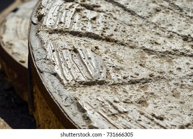 hand carved early American millstone; hand carved and made of stone and metal bands