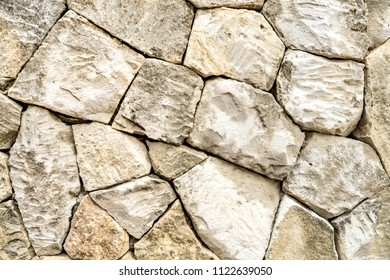 Hand carved sandstone block wall texture background wallpaper.