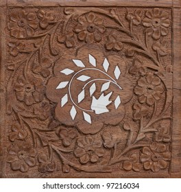 Hand carved wood flower ornament texture painted white in the middle