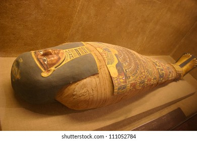 A hand carved wooden sarcophagus in a temple in Egypt contains the remains of a nobleman
