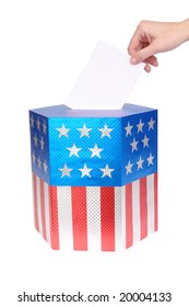 Hand casting vote into ballot box decorated with american flag star and stripe colors over white background