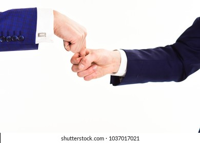 Hand catched traitor or thief in trap. Business stagnation and deadlock concept Hands of two caucasian men interaction in gesture on white background. Body language of relationships and communication.
